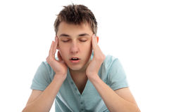 Headache pain discomfort. A boy rubbing temples with a headache migrain or maybe stressed Royalty Free Stock Images