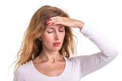 Headache, Pain or healthy concept : Caucasian woman using her ha. Nd and pressing or touching on her head in headache situation isolated on white background Stock Photography