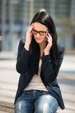 Headache - on the phone Royalty Free Stock Photo