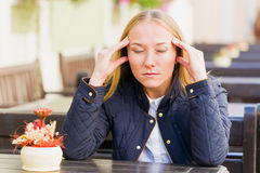 Headache. Photo of stressful young woman with headache Royalty Free Stock Photos