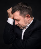 Headache. Man with face closed by hand Royalty Free Stock Photos