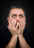 Headache. Man with face closed by hand Stock Photography