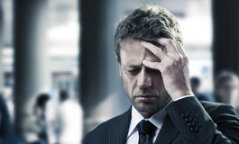 Headache. Portrait of a mature business man with headache Stock Images