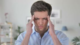 Headache, Portrait of Tense Handsome Young Man in Office stock video footage