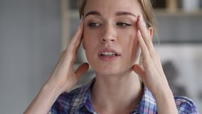 Headache, portrait of tense woman in office stock video