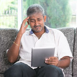 Headache while reading on tablet computer Stock Image