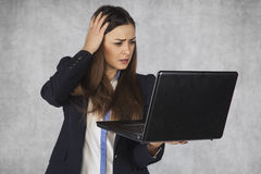 Headache from the sheer volume of information. Business woman royalty free stock images