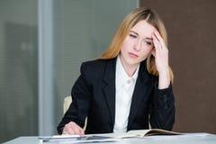 Headache stress tiredness business lady work. Headache stress tiredness concept. young business lady at work stock image
