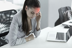 Headache and Stress at Work. Portrait of Young Business Woman at Stock Photo