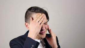 Headache, Stressful Work Overload for Businessman. Grey background stock video footage