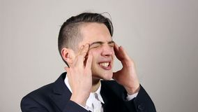 Headache, Stressful Work Overload for Businessman. Grey background stock video