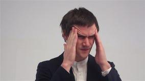 Headache, Stressful Work Overload for Businessman. White background stock footage