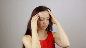 Headache, Stressful Work Overload for a young beautiful woman. Headache, Stressful Work Overload for Businessman. grey background stock footage
