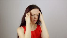 Headache, Stressful Work Overload for a young beautiful woman. Headache, Stressful Work Overload for Businessman. grey background stock video