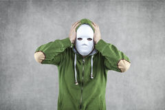 Headache from these strikes. Boy in the mask Stock Photos