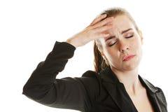 Headache Sufferer. A young woman suffering from an acute headache Stock Photography