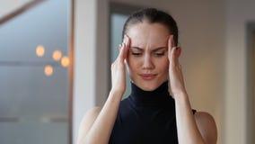 Headache, tense woman in office stock video footage
