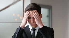 Headache, Tense Young Businessman in Office. 4k  high quality stock video