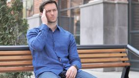 Headache, Tense Young Man Sitting Outdoor on Bench. 4k high quality, 4k high quality stock video footage