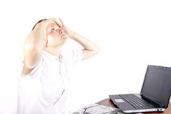 Headache at the tired girl working at the computer.  Royalty Free Stock Image