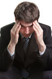 Headache of a tired and stressed businessman Royalty Free Stock Image