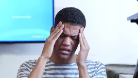 Headache, Upset Tense Young Black Man. Young creative designer , good looking stock footage