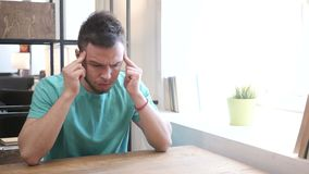 Headache, Upset Tense Young Man. Young creative designer , good looking stock video footage