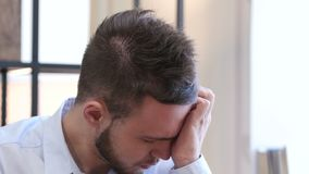 Headache, Upset Tense Young Man. Young creative designer , good looking stock footage