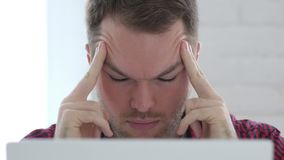 Headache, Upset  Young Man working in Office Close Up stock footage