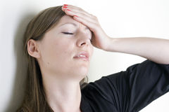 Headache woman Stock Photography