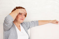 Headache woman Stock Photography