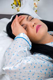 Headache woman on bed Royalty Free Stock Photography