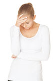 Headache. Woman with a headache holding head, isolated on white background Royalty Free Stock Image