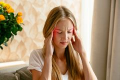 Headache of woman at home. Headache of woman, head pain and stress or depression concept Stock Photography