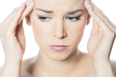 Headache woman. Portrait of a woman felling headache Royalty Free Stock Photography