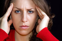 Headache. Woman puts hands on the head.Concept of problems and headache Royalty Free Stock Photography