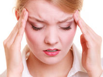 Headache. Woman suffering from head pain isolated. Royalty Free Stock Images