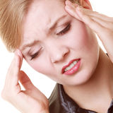 Headache. Woman suffering from head pain isolated. Royalty Free Stock Photos