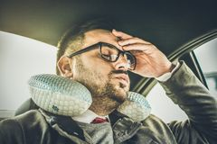 Headache and work are always together. Young business man sitting in car and resting. Close up stock images
