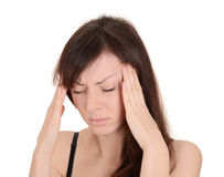 Headache - Young woman holding head in pain isolated on white ba. Ckground Royalty Free Stock Photography
