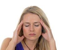 Headaches. Young blond woman has headaches stock photos