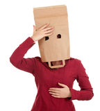 Headachevwoman in paper bag on head Stock Photos