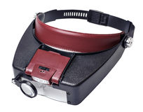Headband magnifer with detachable light source box Stock Photo