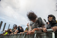 Headbanging crowd in the first row at a hardcore concert. BONTIDA, ROMANIA - JULY  15, 2017: Crowd of hardcore fans headbanging during an Architects concert at Royalty Free Stock Photography