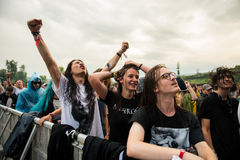 Headbanging crowd in the first row at a hardcore concert. BONTIDA, ROMANIA - JULY  15, 2017: Crowd of hardcore fans headbanging during an Architects concert at Stock Image