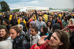 Headbanging crowd in the first row at a hardcore concert. BONTIDA, ROMANIA - JULY  15, 2017: Crowd of hardcore fans headbanging during an Architects concert at Stock Photography