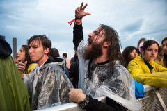 Headbanging crowd in the first row at a hardcore concert. BONTIDA, ROMANIA - JULY  15, 2017: Crowd of hardcore fans headbanging during an Architects concert at Royalty Free Stock Image