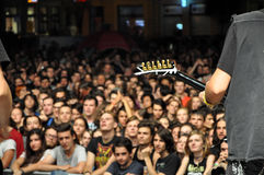 Headbanging crowd at a rock concert. CLUJ NAPOCA, ROMANIA – AUGUST 2, 2015: Headbanging crowd during a rock concert at the Untold Festival Royalty Free Stock Photo