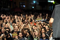 Headbanging crowd at a rock concert. CLUJ NAPOCA, ROMANIA – AUGUST 2, 2015: Headbanging crowd during a rock concert at the Untold Festival Stock Photos