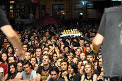 Headbanging crowd at a rock concert. CLUJ NAPOCA, ROMANIA – AUGUST 2, 2015: Headbanging crowd during a rock concert at the Untold Festival Stock Photo